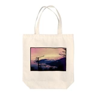 瞬き Tote bags