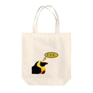 Sleeping penguin Tote bags