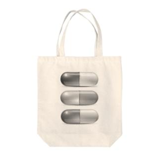 カプセル Tote bags
