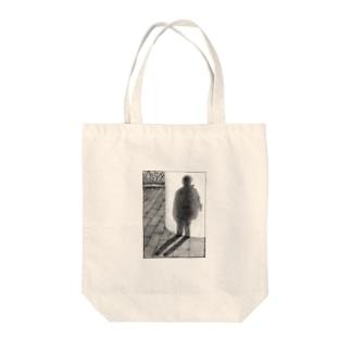 実体のない影 Tote bags