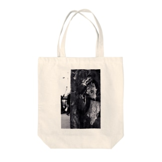 a lady in the wall Tote bags