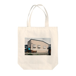 実家 Tote bags