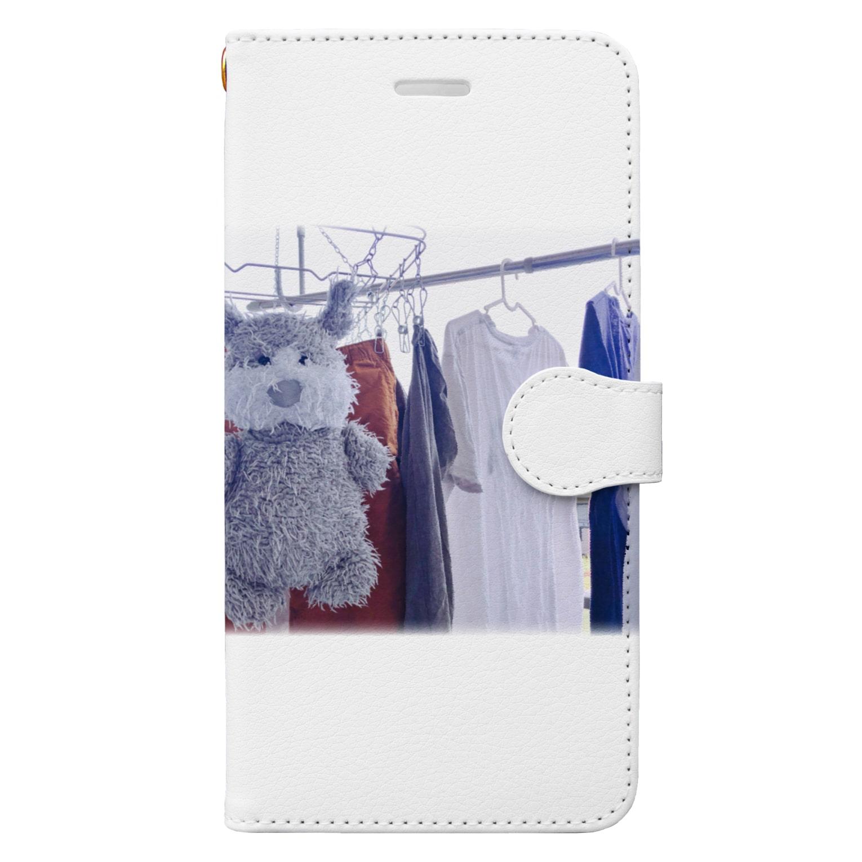 ncncccncの干されこた Book-style smartphone case