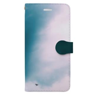 不穏な空にカラス Book-style smartphone case