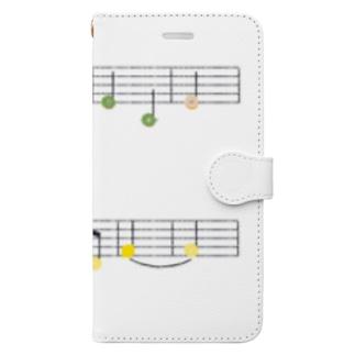 TinyMiry(タイニーミリー)のドーナツとレモンの楽譜 Book-style smartphone case