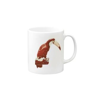 白い花柄の赤いオニオオハシ マグカップ