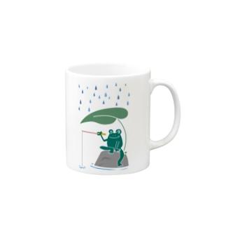 カエルが雨の中釣りをするでケロ Mugs