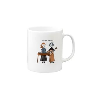 CO UME COMINGS Mugs