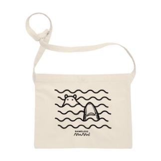 波間のサメとメンダコ Sacoches