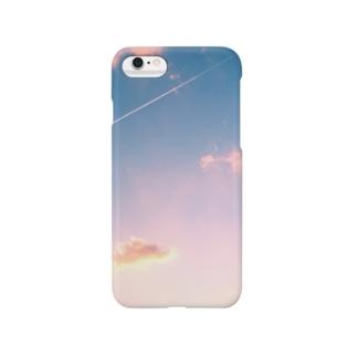 飛行機雲と夕焼け スマートフォンケース