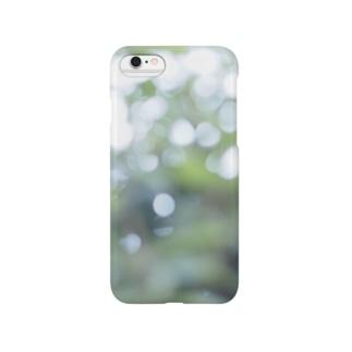 緑の光の粒 Smartphone cases