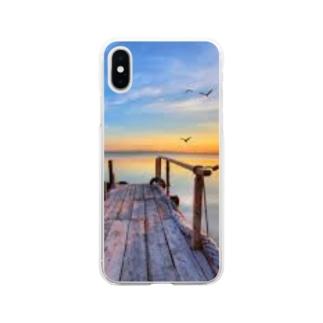 海沿いの夕日 Soft clear smartphone cases