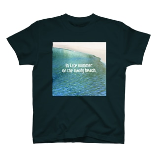 In late summer, on the sandy beach.  T-shirts