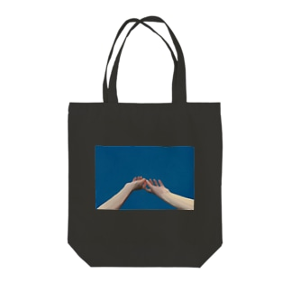 in blue Tote bags