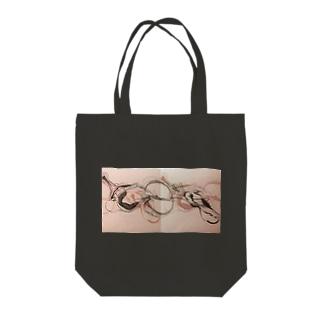 root chakra Tote bags