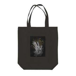 星に手を伸ばす Tote bags