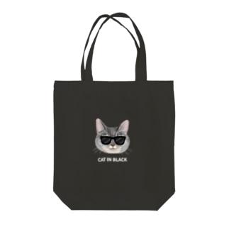 CAT IN BLACK Tote bags