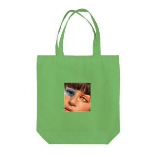 どこか変 Tote bags