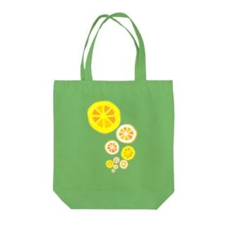 浮上するオレンジ Tote bags