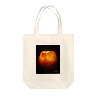 meditation candle Tote bags