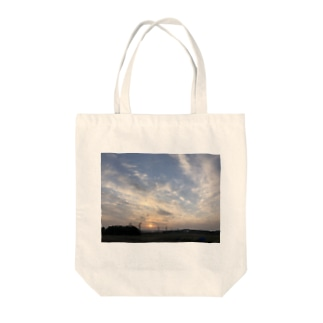 ぼやけた夕日 Tote bags