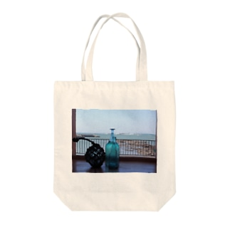 Over the sea Tote bags