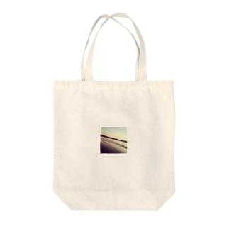 夕陽と海 Tote bags