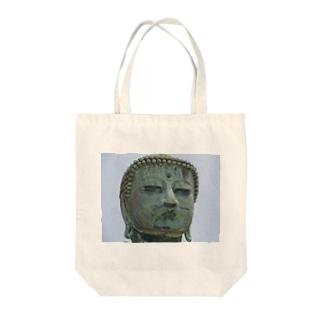 Daibutu Tote bags