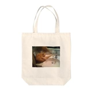 公園のトイレに猫ちゃん発見! Tote bags