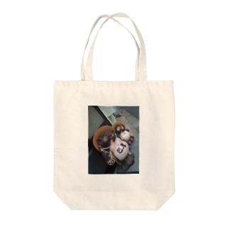 たぬき Tote bags