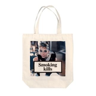 Smoking Kills Tote bags