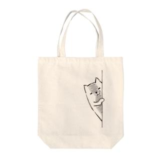 にゃんぺろう ニヤリ Tote bags