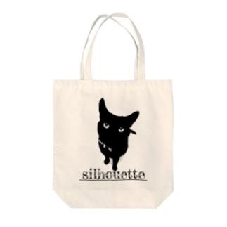 黒猫シルエット Tote bags