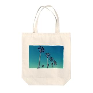 アオゾラヤシ Tote bags