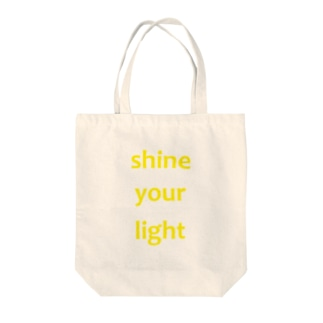 shine your light Tote bags