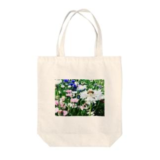 蜂花 Tote bags