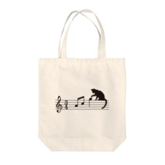 ネコ、音符にイタズラ Tote bags