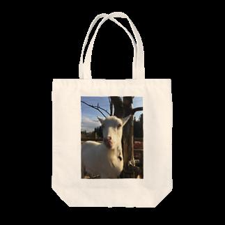 ねっころの舌なめずりヤギ Tote bags