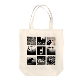 monochrome story Tote bags