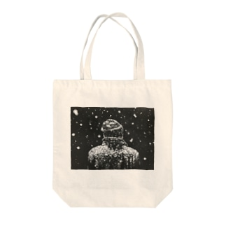 A Man in Snow Tote bags