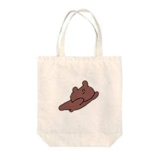 飛ぶクマ Tote bags