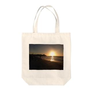 サンセットビーチ Tote bags
