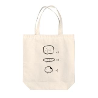 走るパン Tote bags