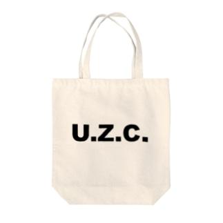 unko zettai company Tote bags