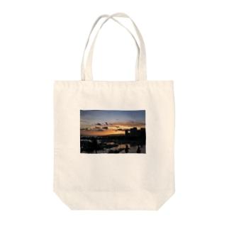 Waikiki's Infinity sunset Tote bags