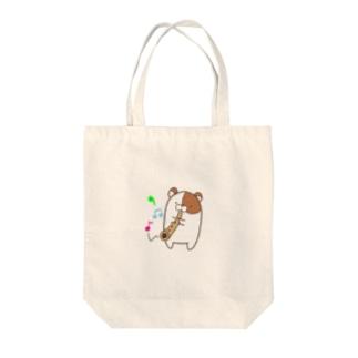 ぴーひょろろー Tote bags