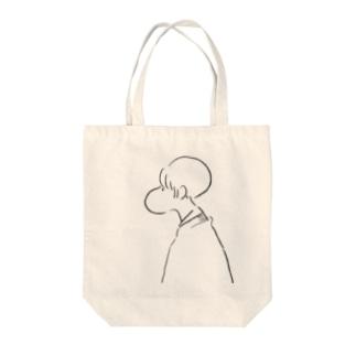 丸顔女の子 Tote bags