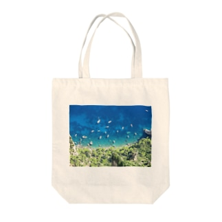 boats and blue sea Tote bags