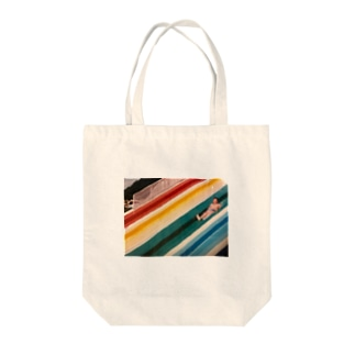 water slide boy Tote bags