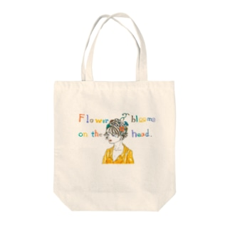 Flower blooms on the head. Tote bags
